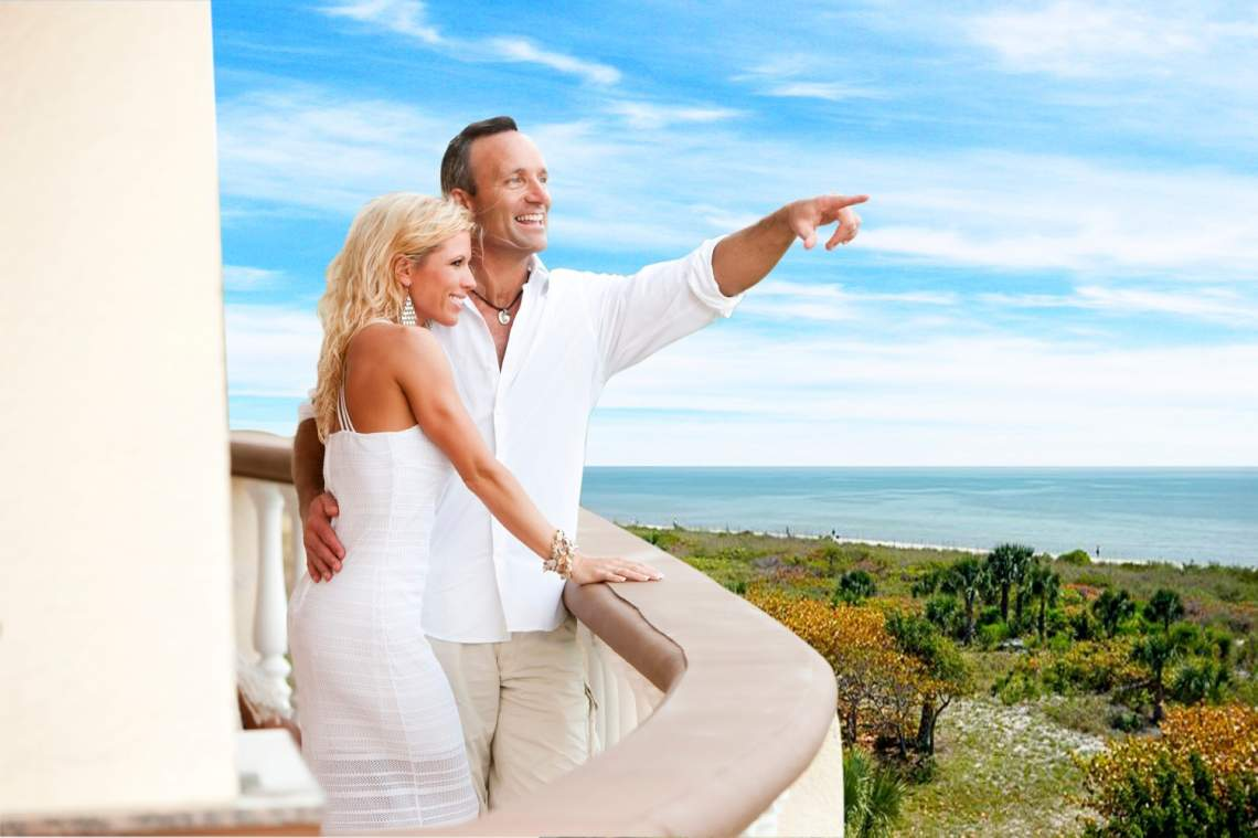 Couple on a Beach-Front Balcony Overlooking the Gulf
